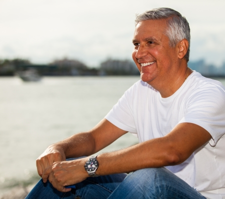 man profile: Handsome middle age man in casual clothing enjoying a Miami Beach park  Stock Photo