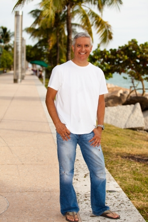 tee shirt: Handsome middle age man in casual clothing enjoying a Miami Beach park  Stock Photo