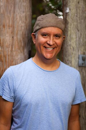 Handsome middle age man in casual clothing wearing a hat outdoors  photo