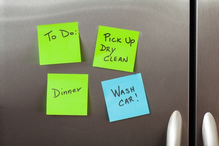 Friendly sticky notes on a kitchen refrigerator door in a home  photo