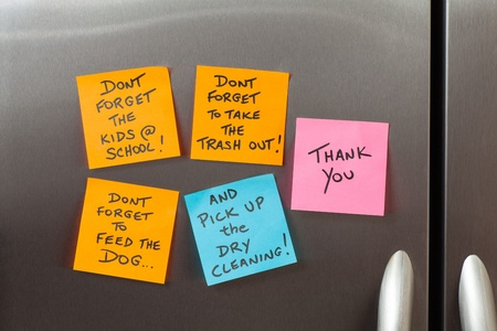 refrigerator: Friendly sticky notes on a kitchen refrigerator door in a home