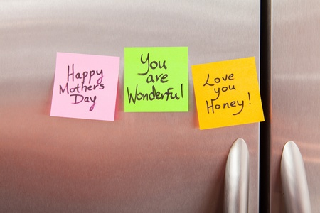 Friendly sticky notes on a kitchen refrigerator door in a home
