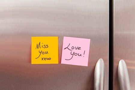 sign post: Friendly sticky notes on a kitchen refrigerator door in a home