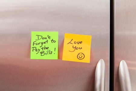 appliance: Friendly sticky notes on a kitchen refrigerator door in a home