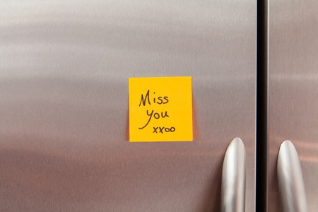 refrigerator kitchen: Friendly sticky notes on a kitchen refrigerator door in a home
