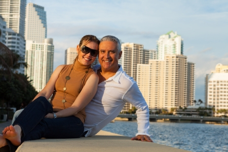 Attractive middle age couple outdoors in a downtown urban bay setting  photo