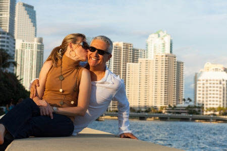 mixed age: Attractive middle age couple outdoors in a downtown urban bay setting