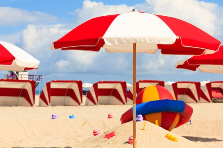 Beautiful Miami Beach with colorful umbrella and cabanas  photo