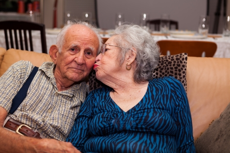 Elderly couple in their 80s being affectionate  photo