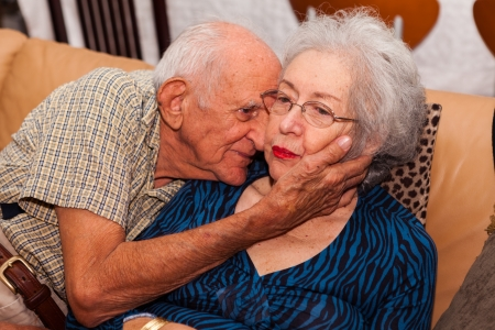 an elderly couple: Elderly couple in their 80s being affectionate