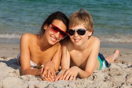 adult sisters: Teenagers enjoying the beach in Miami  Stock Photo