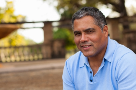 male age 40's: Handsome middle age Hispanic man in casual clothing outdoors  Stock Photo