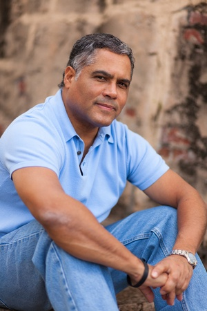 Handsome middle age Hispanic man in casual clothing outdoors  Stock Photo