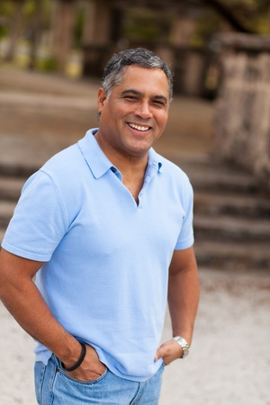 Handsome middle age Hispanic man in casual clothing outdoors  Stock fotó