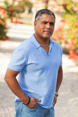 mixed age: Handsome middle age Hispanic man in casual clothing outdoors  Stock Photo