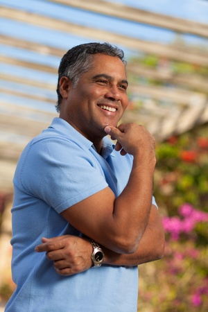Handsome middle age Hispanic man in casual clothing outdoors Stock Photo - 16717777