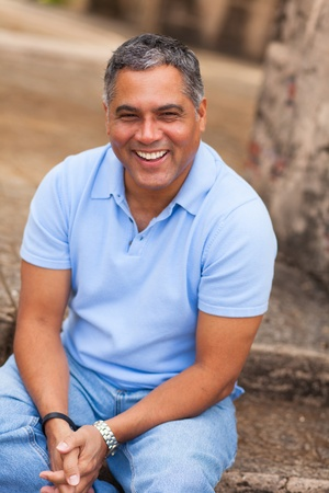 Handsome middle age Hispanic man in casual clothing outdoors  Stock Photo - 16717780