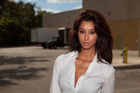 Beautiful young mixed race woman in a fashion pose outdoors  Standard-Bild