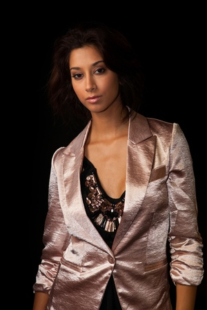 jamaican adult: Beautiful young mixed race woman in a fashion pose on a black background  Stock Photo