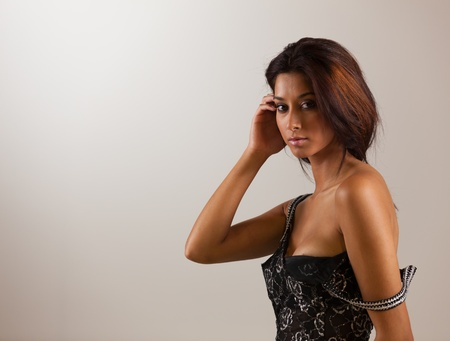 jamaican adult: Beautiful young mixed race woman in a fashion pose