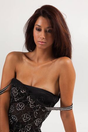 jamaican ethnicity: Beautiful young mixed race woman in a fashion pose