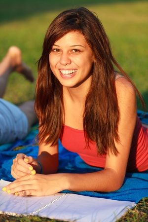 Beautiful multicultural young college woman studying outdoors on campus  Stock Photo - 16963894