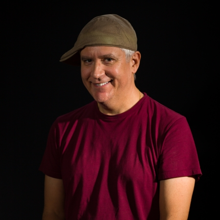 Handsome middle age man wearing a hat on a black background  photo