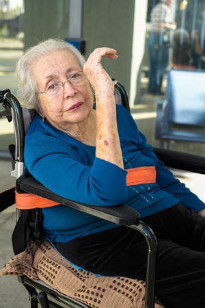 Elderly 80 plus year old woman portrait in a outdoor setting while being transported  Stock Photo - 17335270