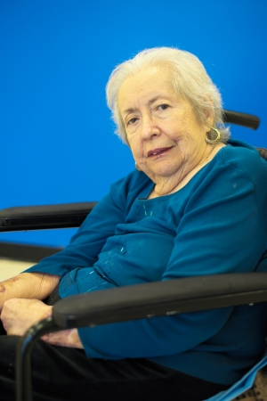 octogenarian: Elderly 80 plus year old woman portrait with a blue background  Stock Photo