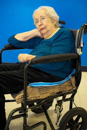 Elderly 80 plus year old woman portrait with a blue background  Stock Photo - 17335257