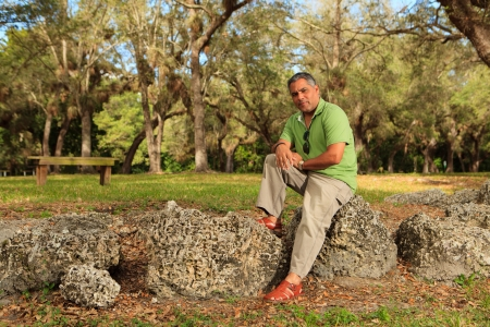 khaki pants: Handsome middle age hispanic man in a park setting  Stock Photo