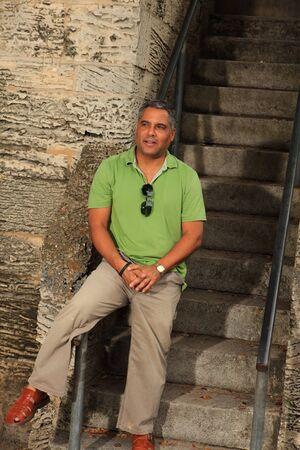 Handsome middle age hispanic man outdoor portrait