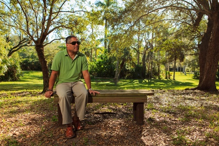 Handsome middle age hispanic man in a park setting  photo