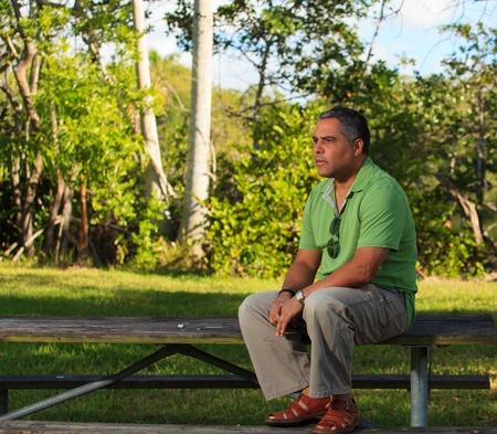 Handsome middle age hispanic man in a park setting  Reklamní fotografie