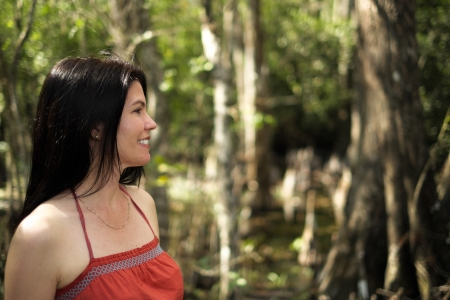 Beautiful woman enjoying the outdoors in the Florida Everglades. photo