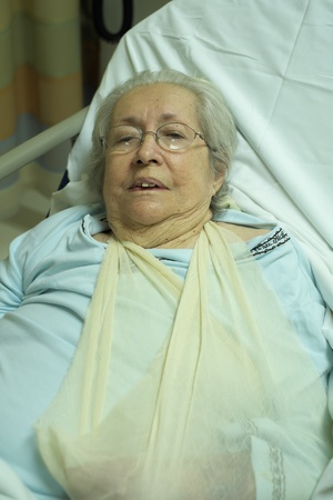 injured woman: Elderly 80 plus year old woman in a hospital bed  Stock Photo