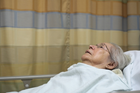 adult 80s: Elderly 80 plus year old woman in a hospital bed  Stock Photo
