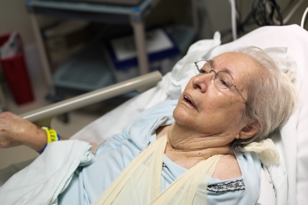 aging woman: Elderly 80 plus year old woman in a hospital bed  Stock Photo
