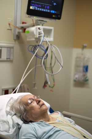 aging american: Elderly 80 plus year old woman in a hospital bed  Stock Photo
