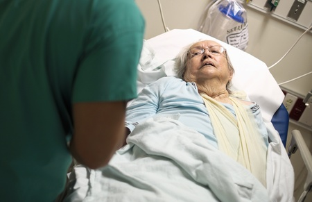 80: Elderly 80 plus year old woman in a hospital bed  Stock Photo