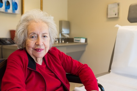 octogenarian: Elderly 80 plus year old woman in a doctors office setting