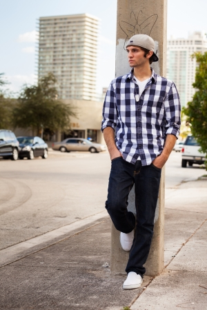 cool guy: Handsome young man outdoors in a downtown urban setting