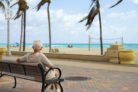 Elderly retired man enjoying the sights of the beach  photo