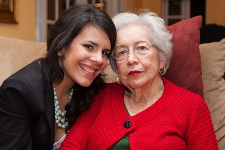 aging woman: Grandmother with granddaughter in a home setting