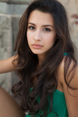 teen girl brown hair: Beautiful multicultural young woman outdoor portrait