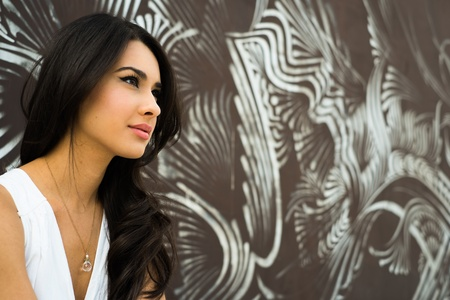 american sexy girl: Beautiful young multicultural woman outdoors with a graffiti background.