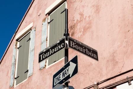 french way: Bourbon and Toulouse street signs in the French Quarter in New Orleans, Louisiana