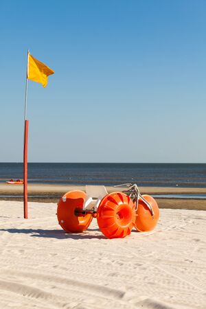 Gulf coast beach in Biloxi, Mississippi with a water tricycle  photo
