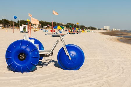 lounge: Gulf coast beach in Biloxi, Mississippi with water tricycles and lounge chairs