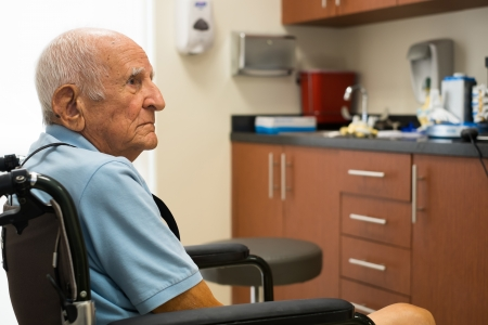 senior citizens: old man in a doctor office setting  Stock Photo